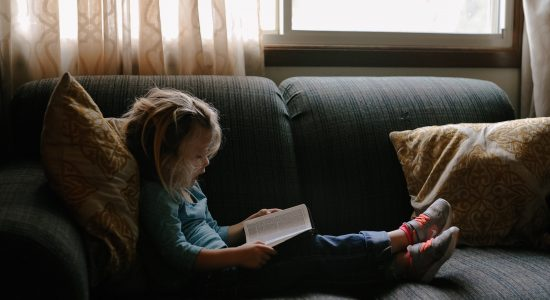 Child reading a book. Picture by Josh Applegate
